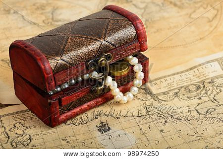 Treasure map, chest and coins