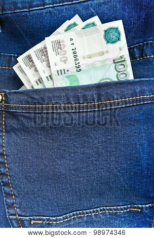 Russian money rubles in blue jeans pocket