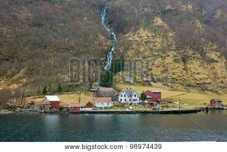 Village in Norway with waterfall, northern landscape