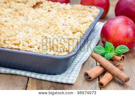 Homemade Plum Crumble Pie In Baking Dish
