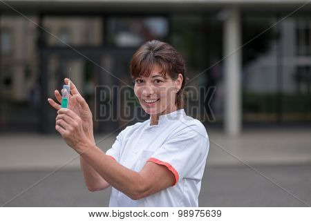 Doctor Or Nurse Holding A Hypodermic