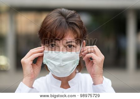 Nurse Or Doctor Wearing A Face Mask Outdoors
