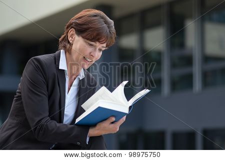 Attractive Woman Sitting Reading A Book