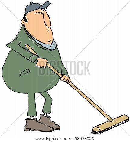 Man using a push broom