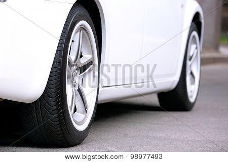 Car wheels outdoors close up