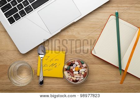 Antivirus set with pills and laptop