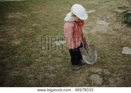 little boy digging a hole