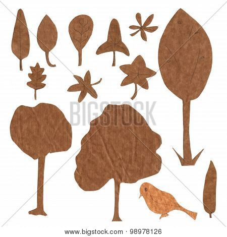 Set of ecology isolated design elements cut out of brown kraft paper: trees, leaves etc