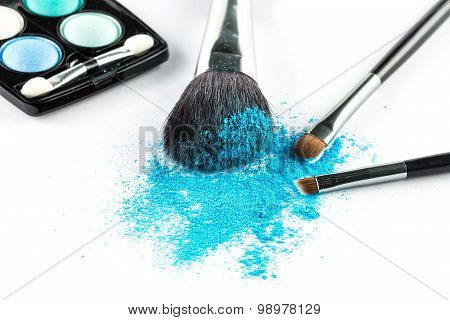 Blue Powder Eyeshadow On A Brush With Make Up Palette
