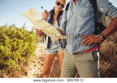 Couple Checking Map While Hiking