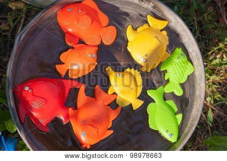 Fish And Other Toy In Water