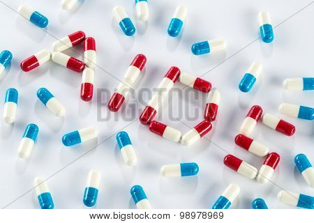 Red Capsule And Blue Capsule In Aids Word