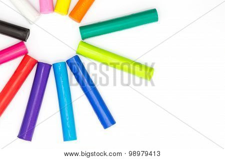 Multiple colour of clay sticks on white background