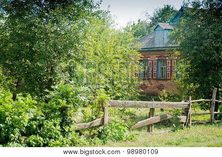 Old Village House Behind Fence