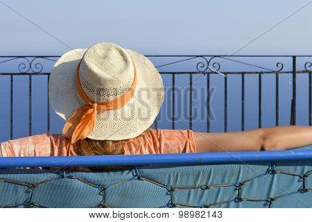 Girl looking at outstanding view at the horizon at Golden fox viewpoint at Corfu Greece