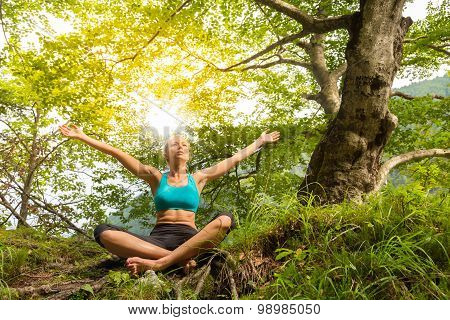 Woman relaxing in beautiful nature.