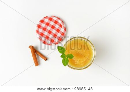 glass of fresh apple sauce on white background