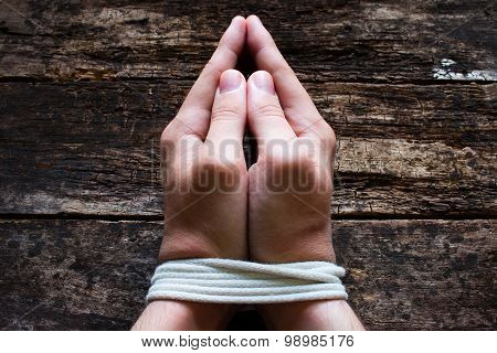 Man Slave Prays With His Hands Tied