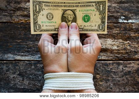 Hands Bound Men And Money In The Hands - A Symbol Of Slavery