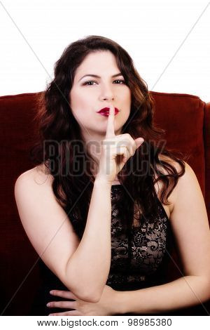 Brunette Caucasian Woman With Finger To Lips
