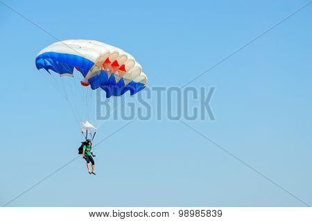 Woman - Skydiver Performs Descent Against Cloudless Blue Sky