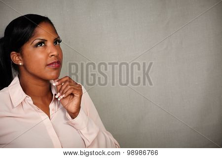 Pensive African Woman Thinking With Hand On Chin