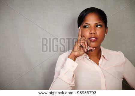 Pensive Woman Planning With Hand On Chin