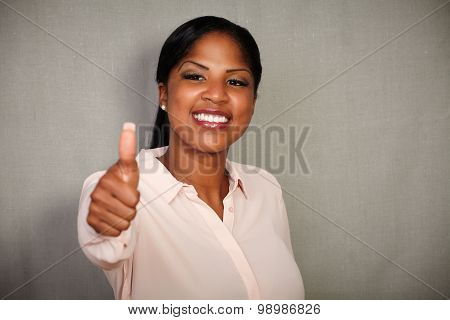 Young Businesswoman Making A Good Job Gesture