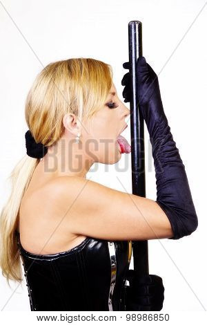 Blond Woman Licking Baton In Black Corset