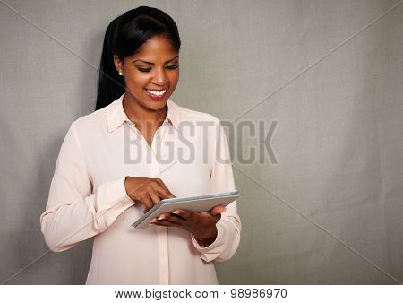Happy Businesswoman Smiling While Using A Tablet