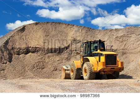 Bulldozer in sand yard