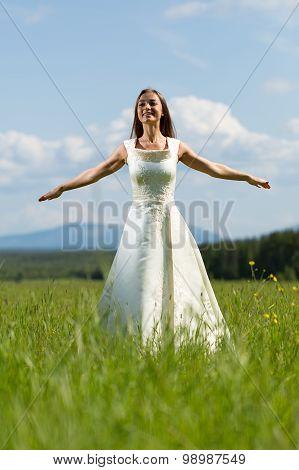 Woman In A Wedding Dress In The Field