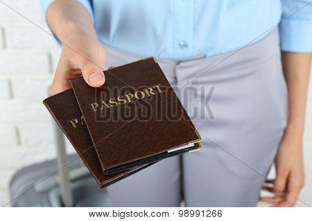 Female hand holding passports, closeup