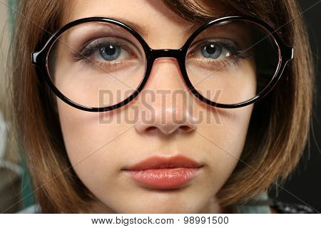 Attractive young woman with glasses close up