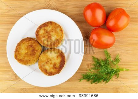 Three Fried Cutlets In Plate, Red Tomatoes And Dill