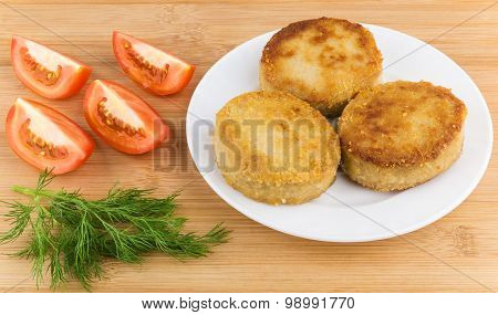 Sliced Tomatoes, Dill And Fried Meatballs In Plate On Table