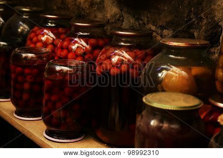 Home preservation in glass jars in cellar, closeup