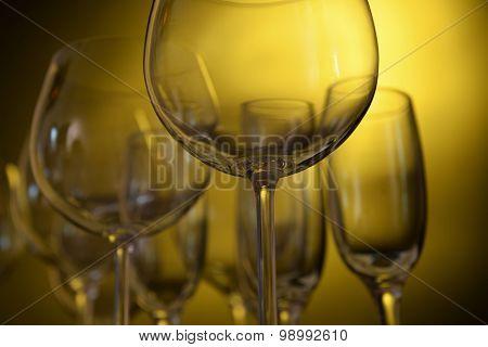 Empty wine glasses on yellow background