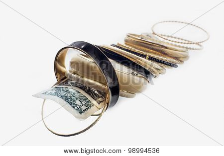 Lot Of Golden Bracelets On One-dollar Bills