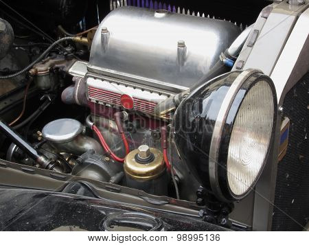 Closeup Of Italian Classic Car Engine And Right Front Light
