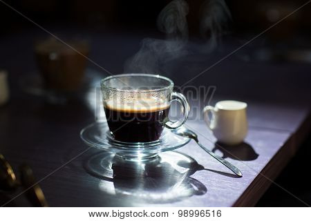cup of hot coffee on the table