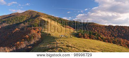 Autumn panorama. Sunny evening in the mountainous village. Carpathians, Ukraine, Europe