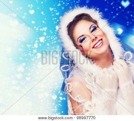 surprised woman wearing a fur-coat, isolated against blue background, winter topic