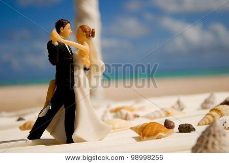 Wedding figurine of bride and groom on the beach