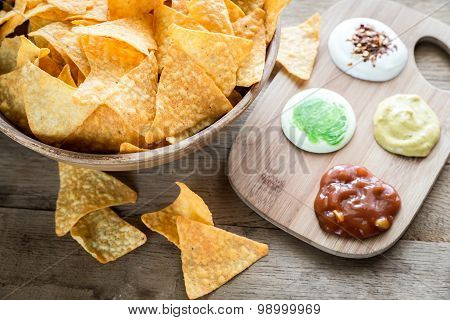 Cheese Nachos With Different Types Of Sauce