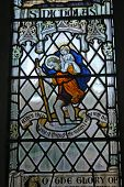stock photo of stained glass  - stained glass window of St Christopher carrying Jesus - JPG