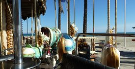 image of carousel horse  - Horses on a carousel overlook the beach in Canet - JPG