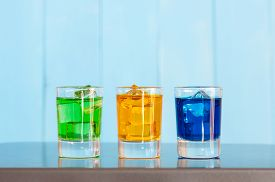 stock photo of shot glasses  - Collection of alcoholic cocktails in shot glasses - JPG