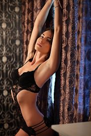 foto of carnal  - picture of lovely girl in lingerie sitting on the sofa outdoor - JPG