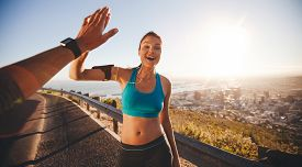 foto of pov  - Fit young woman high fiving her boyfriend after a run - JPG